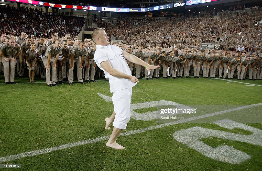 A Texas A&M Aggies yell leader leads a cheer on the field after the Agiies defeated the Ball State Cardinals 56-23 at Kyle Field on September 12, 2015 in College Station, Texas.