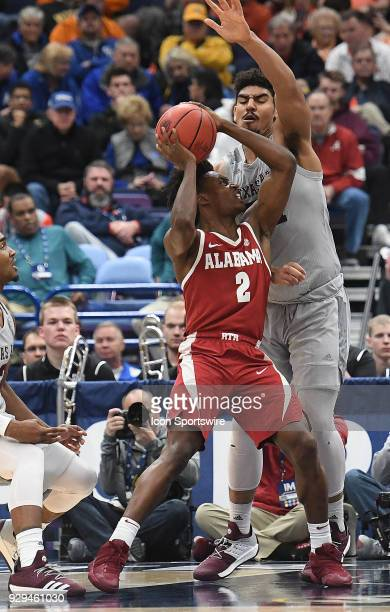 Texas AM forward Tony TrochaMorelos tries to tie up Alabama guard Collin Sexton during a Southeastern Conference Basketball Tournament game between...