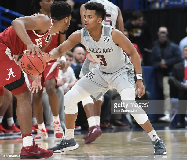 Texas AM guard Admon Gilder guards Alabama forward Braxton Key tightly during a Southeastern Conference Basketball Tournament game between Alabama...