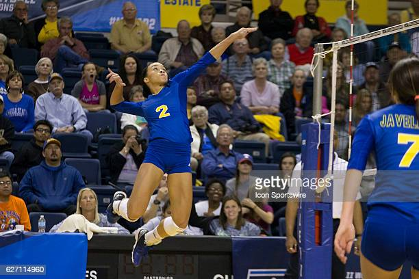 Texas A&M Kingsville outside hitter Krystal Faison jumps to hit the ball during the game between Texas A&M Kingsville Javelina and Angelo State...