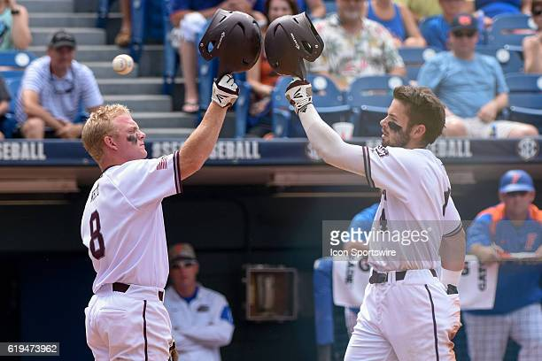 Texas AM outfielder Nick Banks bumps helmets with Texas AM catcher Boomer White after the first of two home runs during the Texas AM 125 win over...
