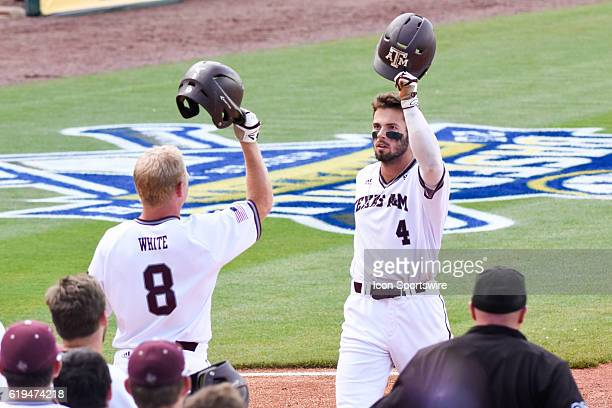 Texas AM outfielder Nick Banks is congratulated by Texas AM's Boomer White after hitting his second home run of the game during the Texas AM 125 win...