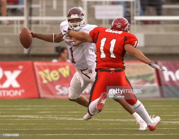 Texas A&M quarterback Reggie McNeal eludes the sack by University of Utah's Kawika Casco during the first quarter Thursday at Rice-Eccles Stadium in...