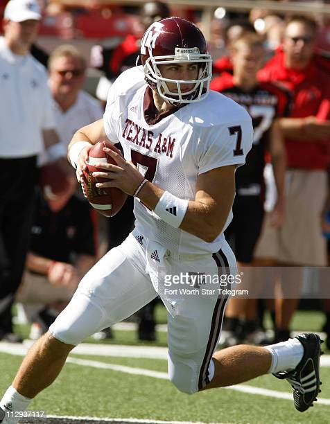 Texas AM quarterback Stephen McGee scrambles with the ball during the Texas AM vs Texas Tech University football game at Jones ATT Stadium in Lubbock...