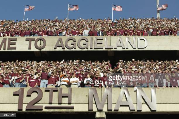 Texas AM University Aggies fans sometimes referred to as the 12th Man stand during the game against the University of Texas at Austin Longhorns at...