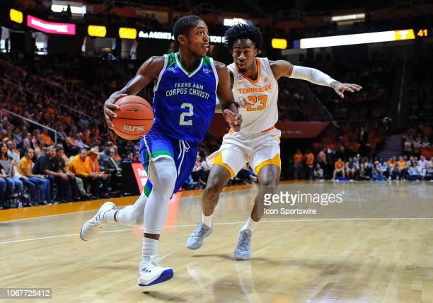 Texas AMCC Islanders guard Myles Smith drives around Tennessee Volunteers guard Jordan Bowden during a college basketball game between the Tennessee...