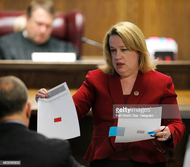 Texas Assistant Attorney General Jane Starnes presents evidence to the defense as she questions former Secret Service computer forensics analyst Jeff...