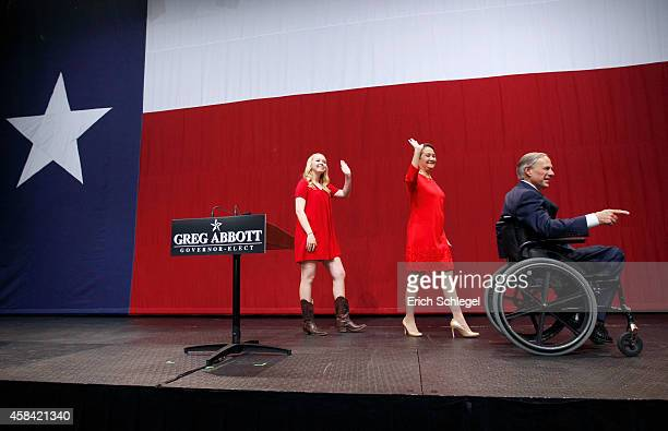 Texas Attorney General and Republican gubernatorial candidate Greg Abbott celebrates with his wife Cecilia and daughter Aubrey during his victory...