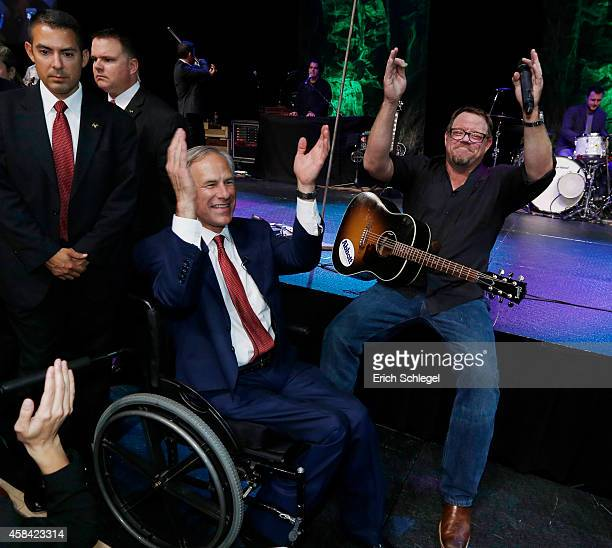 Texas Attorney General and Republican gubernatorial candidate Greg Abbott celebrates with Texas singer Pat Green during his victory party on November...