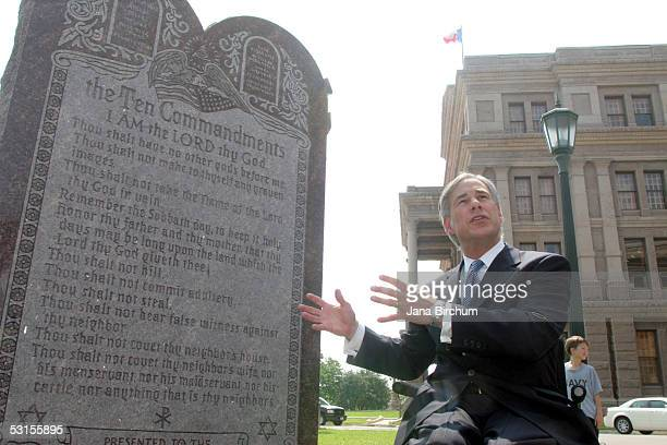 Texas Attorney General Greg Abbott attends a press conference celebrating the US Supreme Court decision that allows a Ten Commandments monument to...