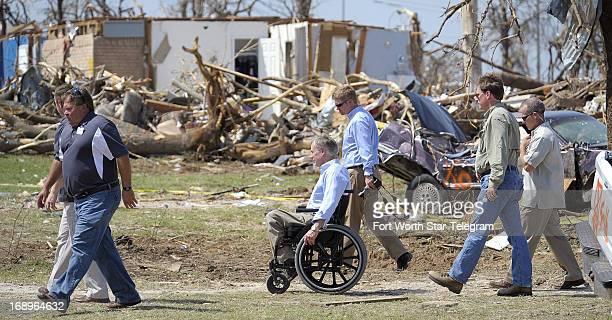 Texas Attorney General Greg Abbott center surveys the tornado damage in the Rancho Brazos Estates subdivision near Granbury Texas Friday May 17 2013...