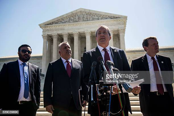 Texas Attorney General Ken Paxton speaks to reporters at a news conference outside the Supreme Court on Capitol Hill on June 9 2016 in Washington DC...