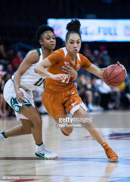 Texas Brooke McCarty making her move towards the basket while Baylor Alexis Morris plays defense during the Big 12 Women's Championship on March 05...