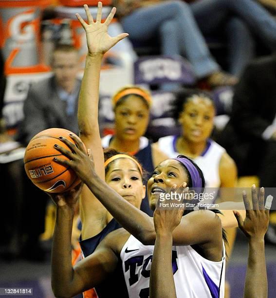Texas Christian center Latricia Lovings shoots against the defensive pressure from UTSA center Whitney Wright at DanielMayer Coliseum in Fort Worth...