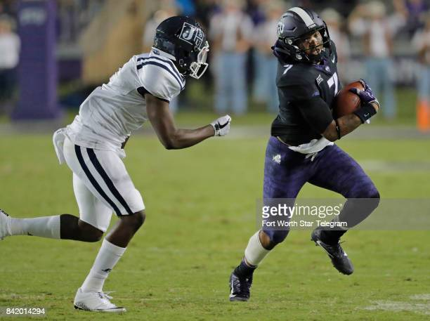 Texas Christian linebacker Arico Evans picks up a fumble and carries it 32 yards for a touchdown in the third quarter against Jackson State at Amon G...