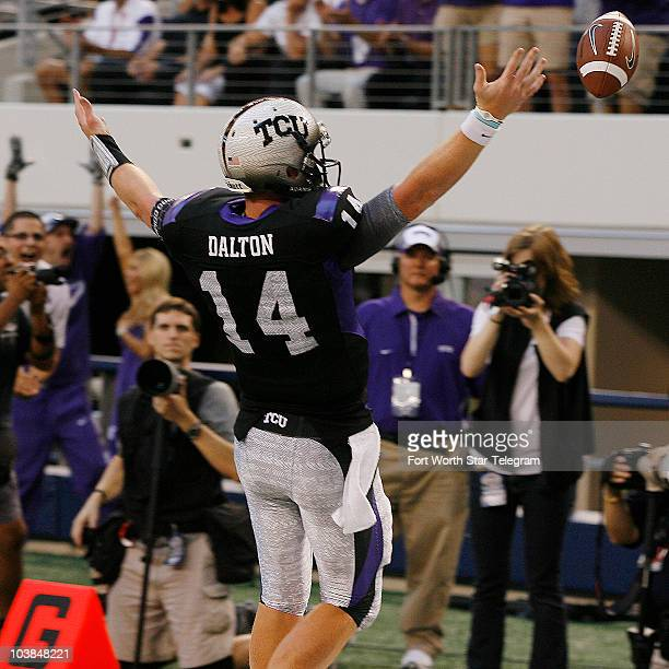 Texas Christian quarterback Andy Dalton celebrates after scoring in the first half against the Oregon Beavers at Cowboys Stadium in Arlington Texas...