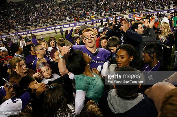 Texas Christian quarterback Andy Dalton is swarmed by fans after the Horned Frogs game against San Diego State University at Amon Carter Stadium in...