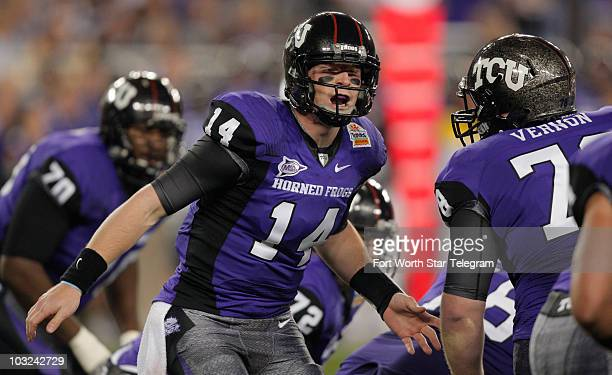 Texas Christian quarterback Andy Dalton struggles to be heard above the noise in the first quarter as the Horned Frogs play Boise State in the...