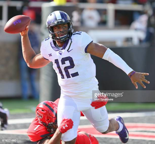 Texas Christian quarterback Shawn Robinson throws as he is brought down by Texas Tech linebacker Jordyn Brooks during the Texas Tech Raider's 273...