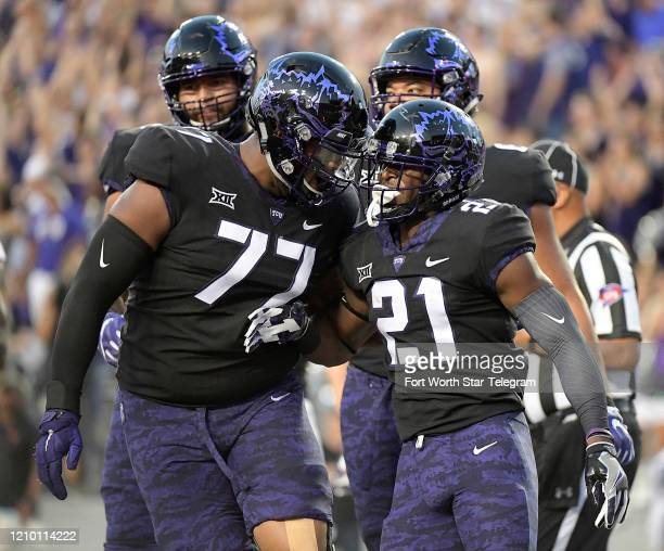 Texas Christian running back Kyle Hicks celebrates a 1yard touchdown run with offensive tackle Lucas Niang during a 2017 game against Texas at Amon G...
