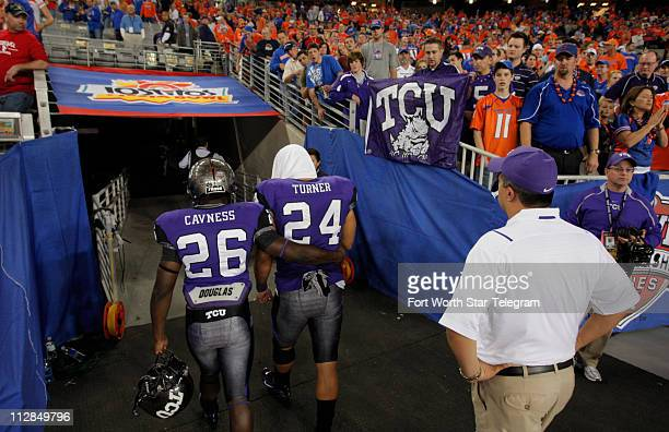 Texas Christian tailbacks Joseph Turner and Jai Cavness leave the field after Boise State defeated TCU 1710 during the Tostitos Fiesta Bowl in...