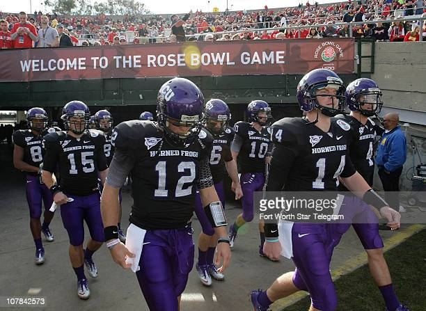 Texas Christian University quarterback Andy Dalton leads his teammates on to the field for pregame warm ups at the Rose Bowl in Pasadena California...