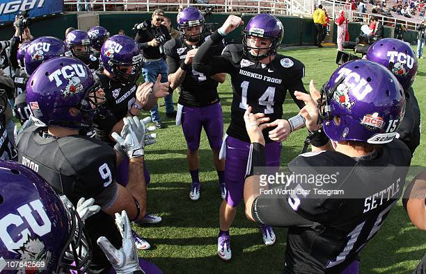 Texas Christian University quarterback Andy Dalton leads the team in a cheer before taking the field for pregame warm ups at the Rose Bowl in...