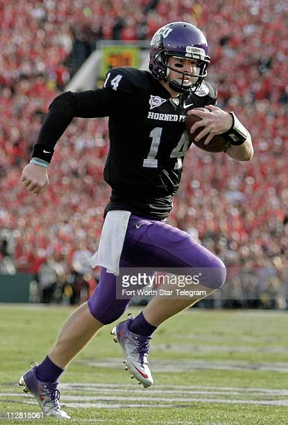 Texas Christian University quarterback Andy Dalton runs for a touchdown against Wisconsin in the first quarter of the Rose Bowl TCU defeated...