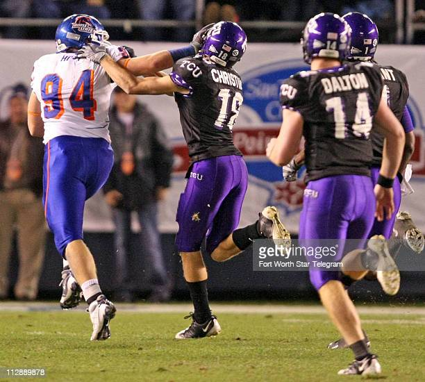 Texas Christian University receiver Ryan Christian saves a touchdown by bringing down Boise State linebacker Bryon Hout on a pass interception run...