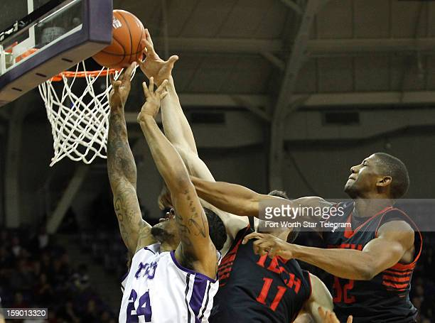 Texas Christian University's Adrick McKinney left tries to score against Texas Tech's Dejan Kravic and Jordan Tolbert in the first half at...