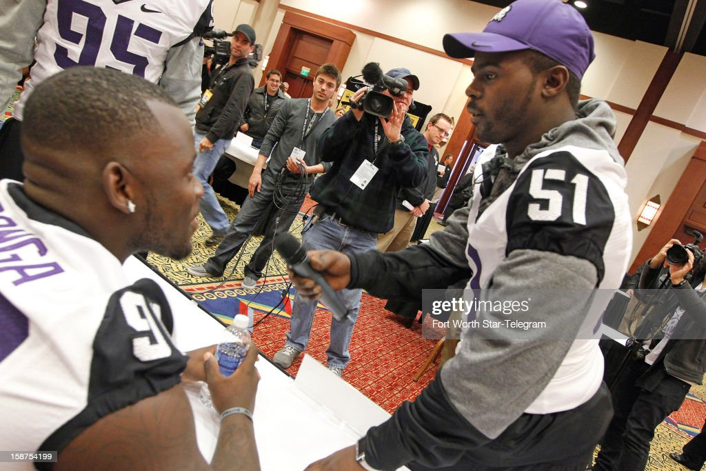 Texas Christian University's Kenny Cain, right, interviews teammate Stansly Maponga for the Buffalo Wild Wings Bowl online camera during a press conference in Scottsdale, Arizona on Thursday, December 27, 2012.
