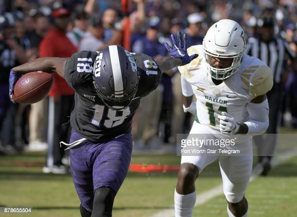 Texas Christian wide receiver Jalen Reagor scores on a 30yard thirdquarter touchdown catch in front of Baylor cornerback Jameson Houston at Amon G...