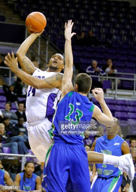 Texas Christian's Addrick McKinney goes up for two against Florida Gulf Coast's Eddie Murray at DanielMeyer Coliseum on Friday November 11 in Fort...
