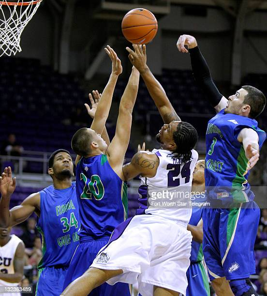 Texas Christian's Addrick McKinney goes up for two against Florida Gulf Coast's Kevin Cantinol Chase Fieler and Eddie Murray right at DanielMeyer...
