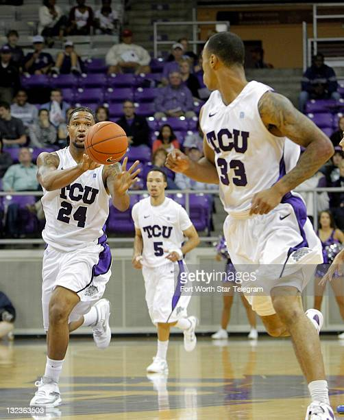 Texas Christian's Addrick McKinney passes the ball to teammate Garlon Green in secondperiod action against Florida Gulf Coast at DanielMeyer Coliseum...
