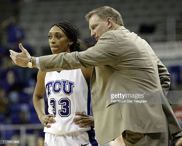 Texas Christian's Adrienne Ross listens to head coach Jeff Mittie during TCU's game against Brigham Young at the Daniel Meyer Coliseum in Fort Worth...