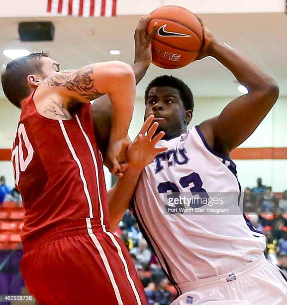Texas Christian's Chris Washburn tries to muscle his way to the basket against Oklahoma's Ryan Spangler during the first half at the WilkersonGreines...