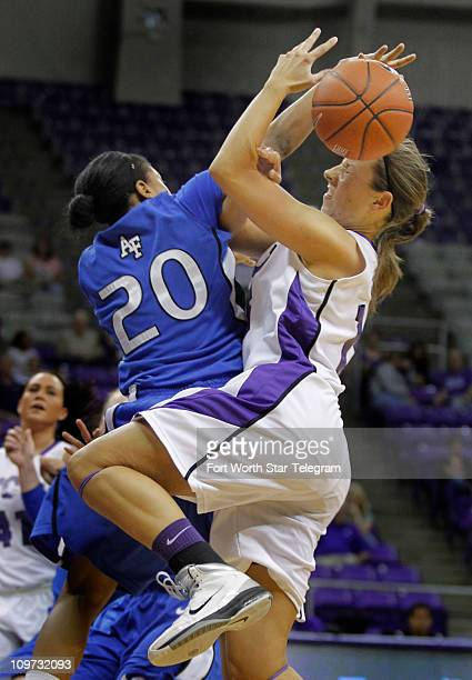Texas Christian's Emily Carter right is fouled by Air Force's Camille Thompson in secondhalf action at DanielMeyer Coliseum in Fort Worth Texas on...