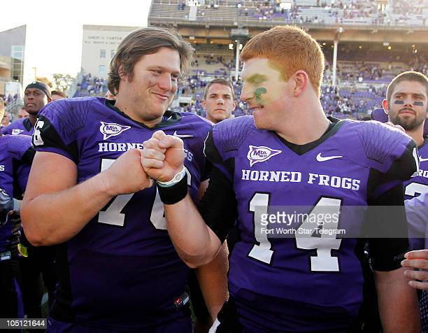 Texas Christian's Jake Kirkpatrick bumps fists with quarterback Andy Dalton after their 450 win over Wyoming during an NCAA football game at Amon G...
