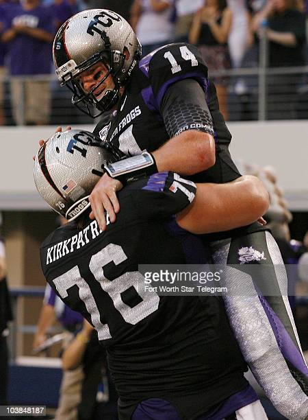 Texas Christian's Jake Kirkpatrick congratulated quarterback Andy Dalton who scored during the first quarter against the Oregon Beavers at Cowboys...