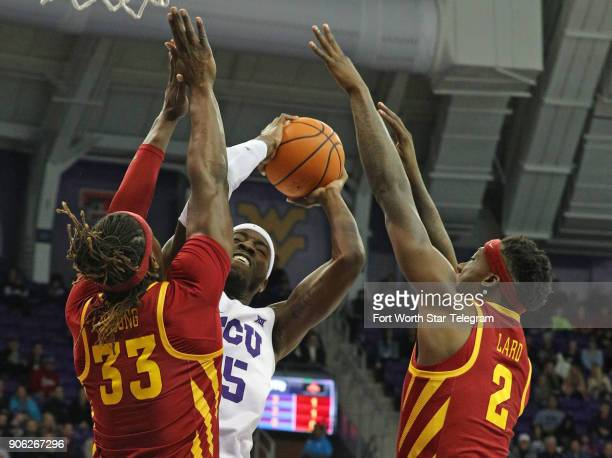 Texas Christian's JD Miller tries to put up a shot against Iowa State's Solomon Young and Cameron Lard at Schollmaier Arena in Fort Worth Texas on...