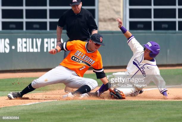 Texas Christian's Nolan Brown steals third base against Oklahoma State third baseman Garrett Benge in the fifth inning on Sunday March 26 2017 at...