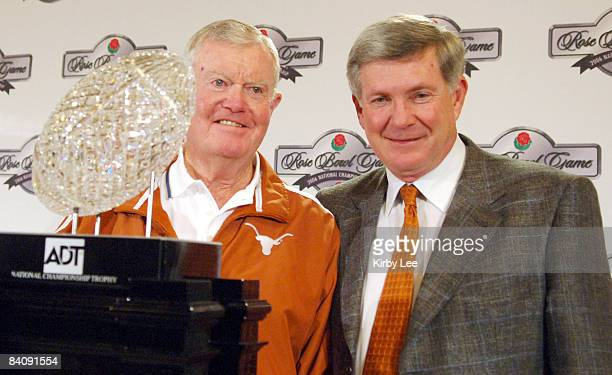 Texas coach Mack Brown and former Longhorn coach Darrell Royal pose with the ADT National Championship Trophy at the Beverly Hilton in Beverly Hills,...
