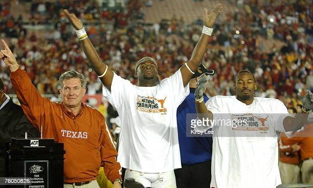 Texas coach Mack Brown, Vince Young and Michael Huff celebrate 41-38 victory over USC in the BCS National Championship game at the Rose Bowl in...