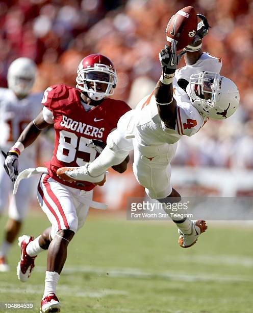 Texas cornerback Aaron Williams was unable to intercept this pass intended for Oklahoma's Ryan Broyles during the second quarter at the Cotton Bowl...
