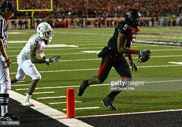 Texas cornerback Curtis Brown defends as Texas Tech wide receiver Michael Crabtree catches scores the game winning touchdown during Texas Tech's...