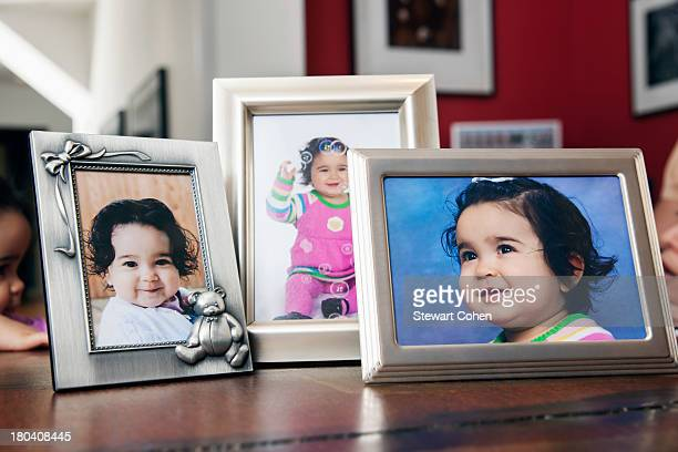 USA, Texas, Dallas, Children's portraits in frames on table