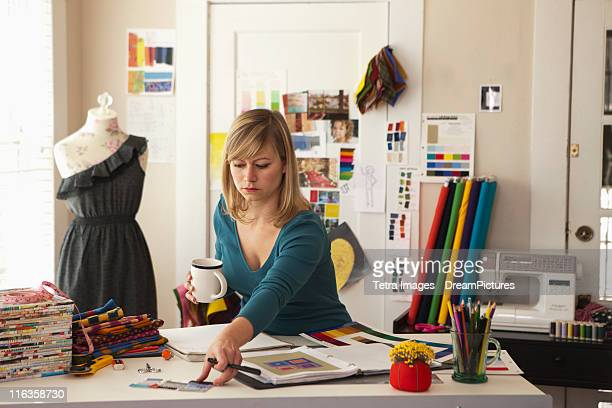 usa, texas, dallas, female fashion designer working in office - dress cleavage stock pictures, royalty-free photos & images