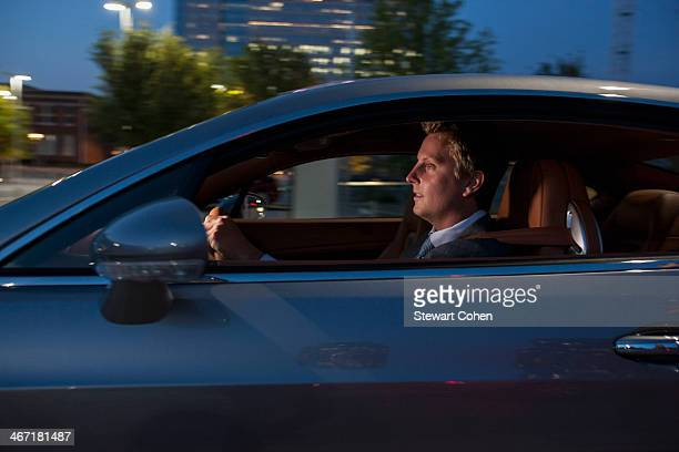 USA, Texas, Dallas, Profile of businessman driving car