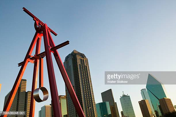 USA, Texas, Dallas, Proverb sculpture and skyline, low angle view